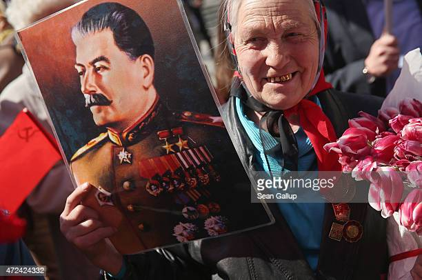 An elderly woman holds a portrait of World War II Soviet leader Josef Stalin near Red Square ahead of celebrations to mark the 70th anniversary of...