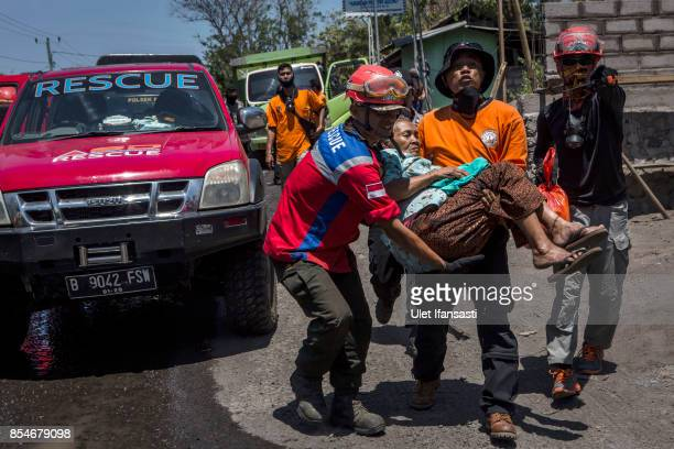 KARANGASEM BALI INDONESIA SEPTEMBER 27 An elderly woman is carried by search and rescue staff as being evacuated from their village on September 27...