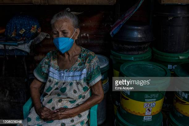 An elderly woman is seen wearing a face mask at a slum community on March 23 2020 in San Juan Metro Manila Philippines The Philippine government has...