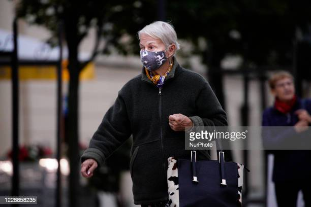 An elderly woman is seen wearing a face mask in Warsaw, Poland on October 2, 2020. Poland has seen its novel cases of coronavirus infections rise for...