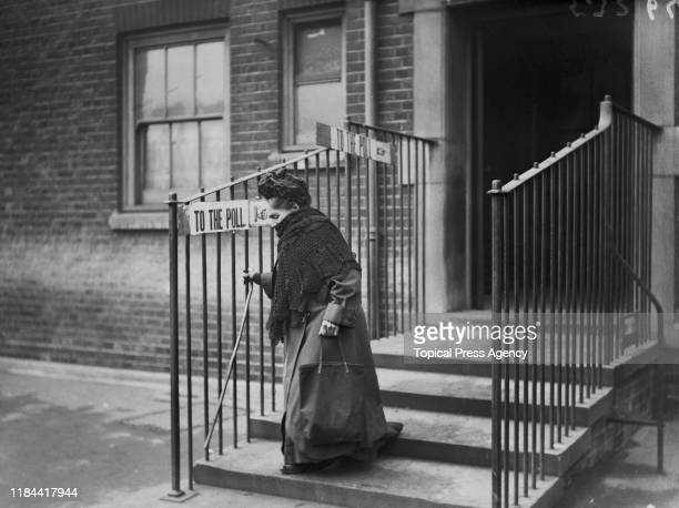 An elderly woman leaves a polling station in Islington, north London, after casting her vote in the general election, 6th December 1923.