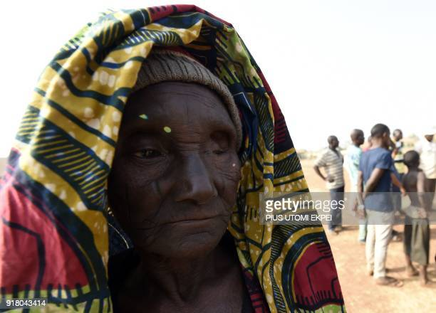 An elderly woman looks on at the internally displaced people camp occupied largely by women and children affected by herders and farmer's violent...