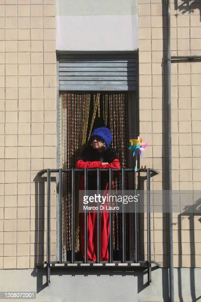 An elderly woman looks out onto her home balcony during lockdown on March 23 2020 in Rome Italy As Italy extends its nationwide lockdown to control...