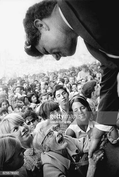 An elderly woman nearly screams in delight as she shakes the hand of Senator Robert F Kennedy as he campaigns in Indiana 1968