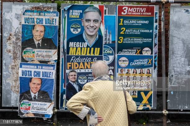 An elderly woman observes election posters on May 26 2019 in Milan Italy More than 430 million people all over the European Union are eligible to...