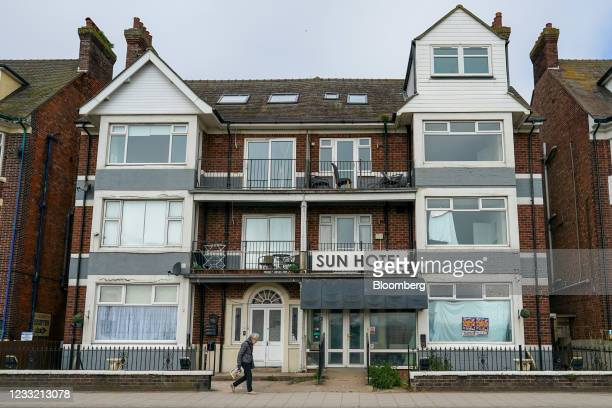 An elderly woman passes a hotel in Skegness, U.K., on Monday, May 31, 2021. U.K. Health Secretary Matt Hancock said people who want to go on holiday...