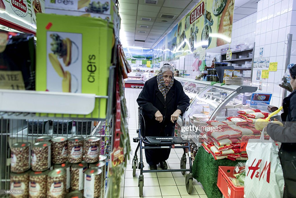 An elderly woman passes a shelf with goods in the Turkish supermarket Marketler at Karl-Marx-Strasse in Neukoelln district on November 02, 2013 in Berlin, Germany. According to recently published statistics, 7.2 million foreigners were living in Germany by the end of 2012, which is the highest number ever recorded. Of those 80% are from countries in the European Union, while the rest come primarily from Turkey, Russia, the former Soviet states and Arab countries.