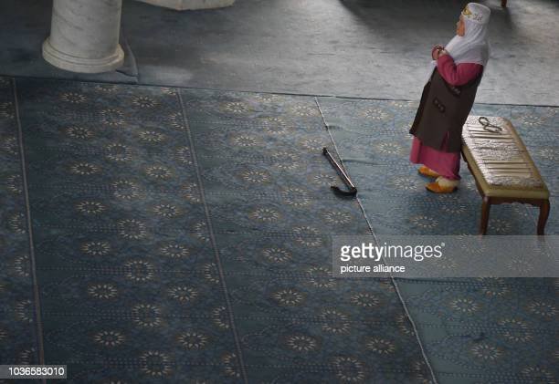 An elderly woman prays in the Qol Sharif mosque in the city of Kazan Russia 11 July 2015 Photo Marcus Brandt/dpa | usage worldwide