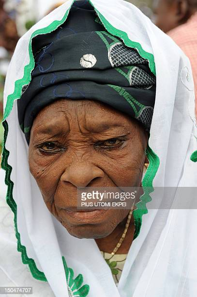 An elderly woman prays on the first day of Eid alFitr at Obalende praying ground in Lagos on August 19 2012 Muslims around the world celebrate Eid...