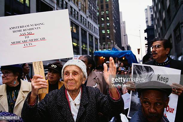 An elderly woman protesting cuts to Medicare and Medicaid at a health care march and rally sponsored by the Keep Patients First Save Our Health Care...