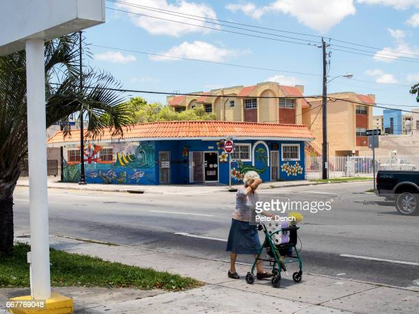 An elderly woman pushes her shopping through the Little Havana area of Miami Miami is a seaport city on the Atlantic Ocean in south Florida Miami's...