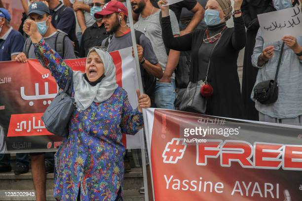 An elderly woman raises fist as she shouts slogans, during a demonstration held in Tunis, Tunisia, on September 11 to call for the release of the...