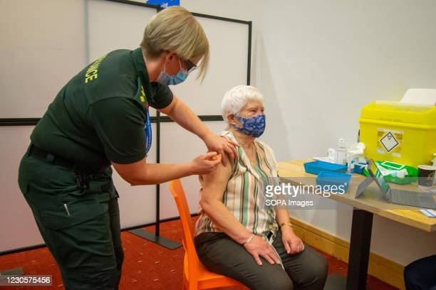 An elderly woman receives an injection of a Covid-19 vaccine at a NHS vaccination centre that has been set up at the Life Science Centre. Several...