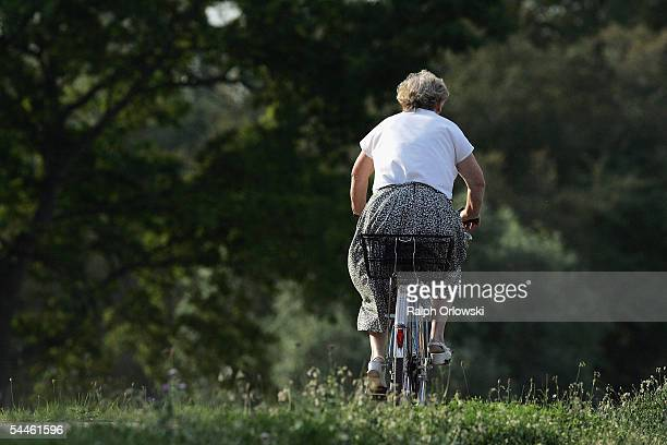 An elderly woman rides a bicycle on September 3 2005 in Ruesselsheim Germany Germany's economy and pension system is being burdened by an expanding...