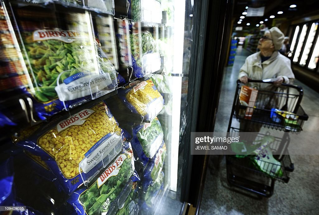 An elderly woman shops at Wegmans Foods : News Photo