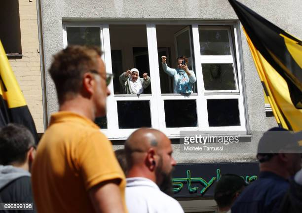 An elderly woman shout at the Supporters of the Identitarian Movement march on June 17 2017 in Berlin Germany The Identitarian Movement originated in...
