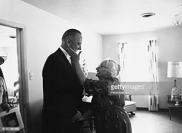 An elderly woman shows her gratitude to President Lyndon B Johnson for his signing of the Medicare health care bill in April 1965