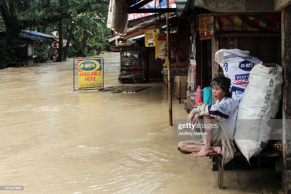 An elderly woman sits out front of her flooded home after heavy rains and strong winds, brought about by Typhoon Bopha, hit the township of Mabini on December 04, 2012 in the province of Compostela Valley in the southern Philippines. Typhoon Bopha made landfall in the southern Philippines earlier today, bringing heavy rain and wind gusts of 210 km/h (130mph). So far at least 40 have died and over 40,000 people have been forced into shelters.