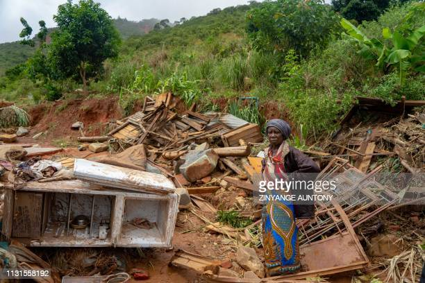 An elderly woman stands next to her destroyed belongings on March 19 in Chimanimani after the area was hit by the Cyclone Idai More than a thousand...
