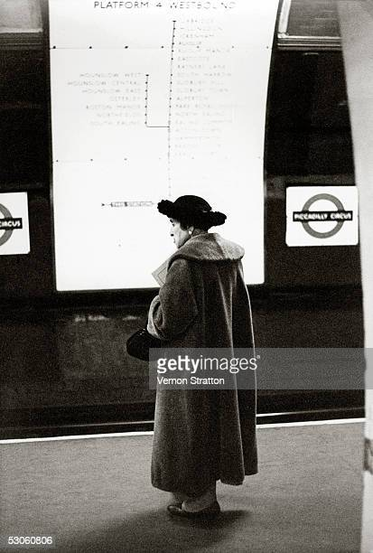 An elderly woman waiting for a train at Piccadilly Circus underground station London circa 1961