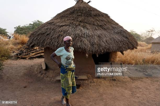 An elderly woman walks in front of mud house in Tse Chagu on the outskirts of Makurdi capital of Benue State in northcentral Nigeria on January 4...
