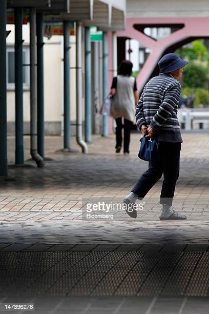 An elderly woman walks through a local housing complex in Kashiwa City Chiba Prefecture Japan on Thursday June 28 2012 Japan ages faster than any...