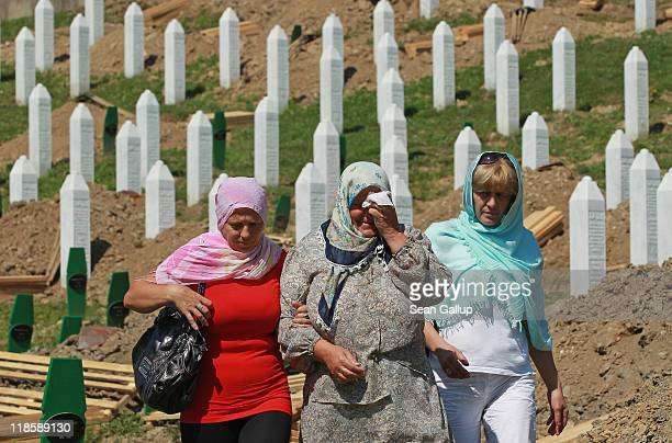 An elderly woman weeps after visiting a gravesite among the thousands of victims of the 1995 Srebrenica massacre buried at the Potocari cemetery and...