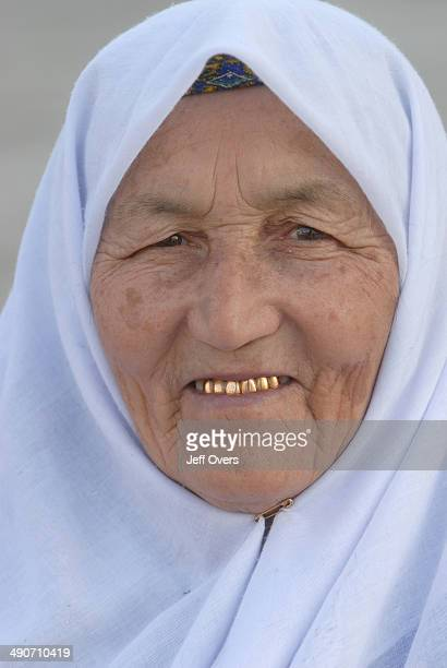 An elderly woman with a fine set of gold teeth in Samarkand Uzbekistan Former Soviet union republic Uzbek Muslim Moslem Islam Islamic religious head...