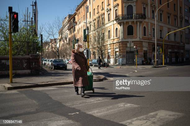 An elderly woman with a shopping cart and a protective mask crosses via Prenestina to be able to go shopping on April 7 2020 in Rome The Italian...