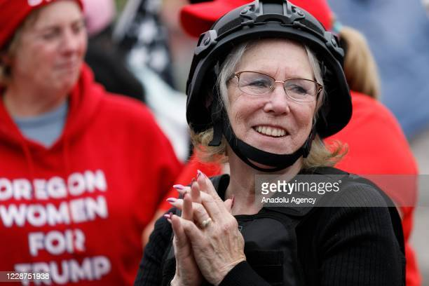 An elderly woman Women for Trump is seen as the Proud Boys a rightwing proTrump group gather with their allies in a rally called âEnd Domestic...