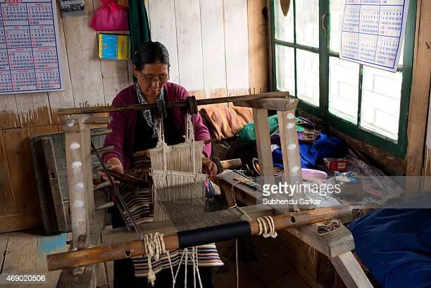 An elderly woman works at a handloom at Tibetan Refugee Self Help Centre The Tibetan Refugee Self Help Centre of Darjeeling was started on October 2...