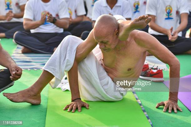 An elderly yoga practitioner participates in a mass yoga session on International Yoga Day at Rajpath on June 21 2019 in New Delhi India The...