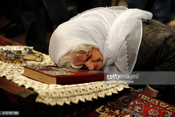 An eldery woman attends a religious service at the cathedral in Etchmiadzin outside Yerevan on April 23 ahead of the canonization ceremony for the...