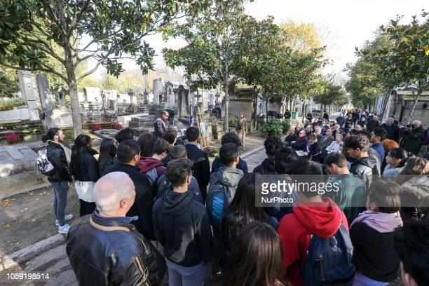 An elected official is speaking near the French poet Guillaume Apollinaires portrait during a ceremony held on Novembre 8 at the grave of the poet at...