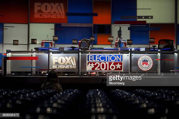 An Election 2016 sign hangs on the moderator desk ahead of the Republican presidential candidate debate at the North Charleston Coliseum and...