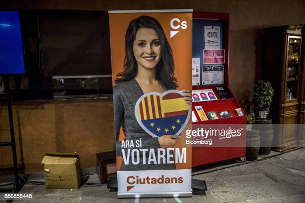 An election banner promoting Ines Arrimadas head of Ciudadadanos in the Catalan Parliament stands on display at an event to launch the party's...