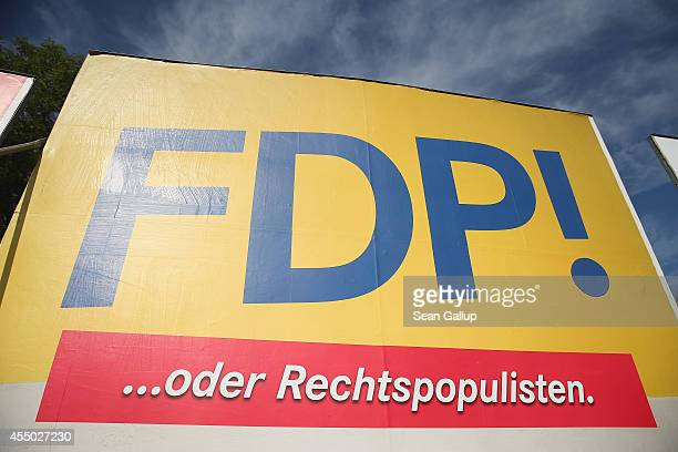 An election campaign billboard of the German Free Democrats that reads 'FDP or rightwing populists' stands ahead of upcoming Brandenburg state...