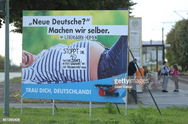 An election campaign billboard of the rightwing Alternative for Germany political party that reads 'New Germans We'll make them ourselves Be brave...