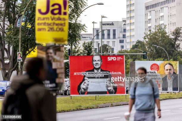 An election campaign billboard showing Olaf Scholz , chancellor candidate of the German Social Democrats , stands on August 23, 2021 in Berlin,...
