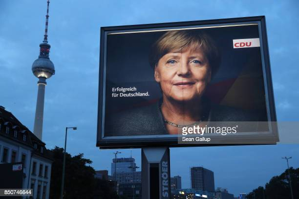 An election campaign billboard that shows German Chancellor and Christian Democrat Angela Merkel stands near the broadcast tower at Alexnderplaz on...