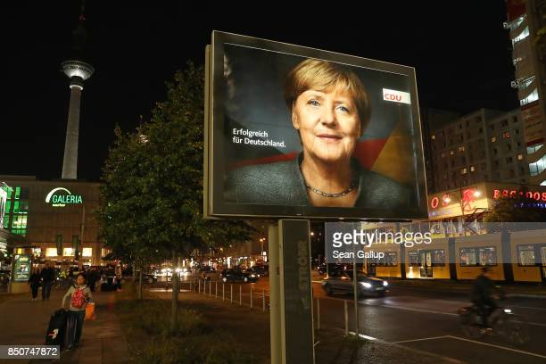 An election campaign billboard that shows German Chancellor and Christian Democrat Angela Merkel stands near the broadcast tower at Alexanderplaz on...