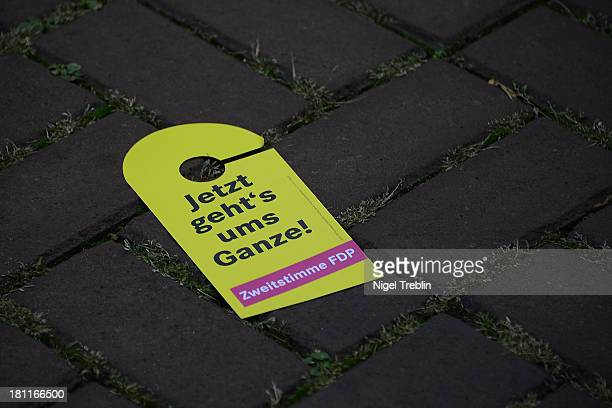 An election campaign flyer of German Free Democrats lies on the ground pictured at a party's election campaign on September 19 2013 in Hanover...