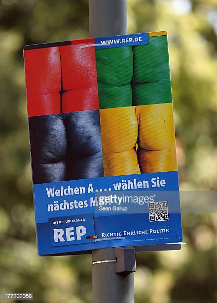 An election campaign poster of the farright Die Republikaner party featuring male buttocks painted in the colours of the four largest political...