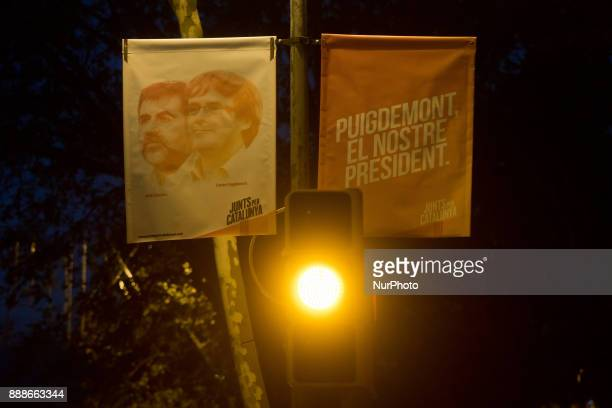 An election campaign poster showing candidates of the Junts Per Catalunya party Catalonia's deposed regional president Carles Puigdemont and civil...