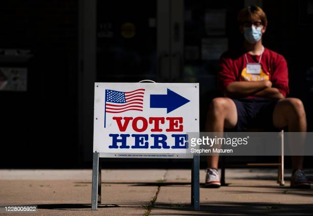 An election judge directs voters outside a polling place in the Pearl Park Recreation Center on August 11, 2020 in Minneapolis, Minnesota. Amongst...