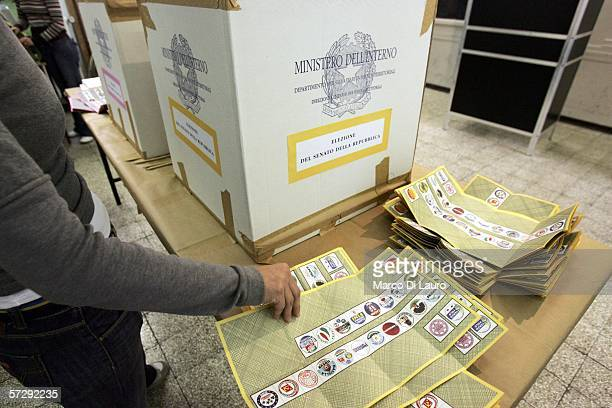 An election official holds ballots at a polling station April 9 2006 in Rome Italy About 47 million Italians are eligible to vote on April 9 and...