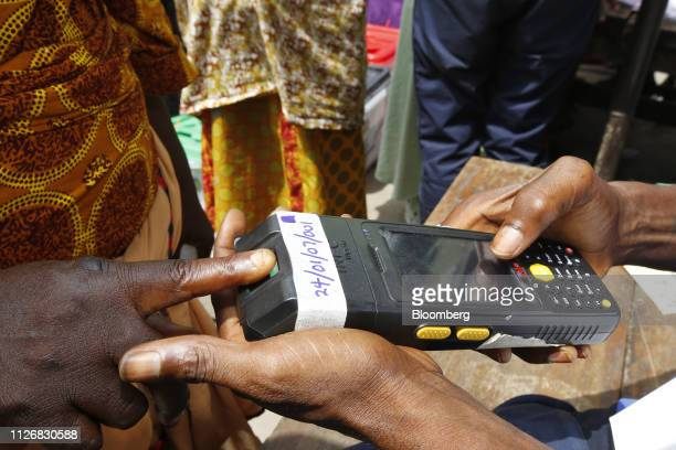 An election official records a voter identity at a polling station in Lagos Nigeria on Saturday Feb 23 2019 Nigerians began voting in Africas biggest...
