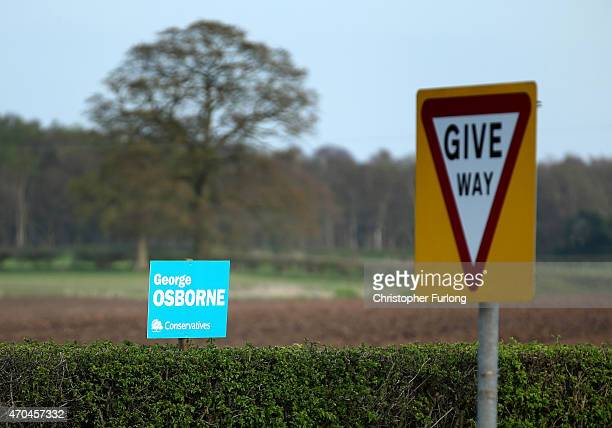 An election poster for Chancellor George Osborne sits on a hedge in his Tatton constituency on April 20 2015 in Knutsford United Kingdom Britain will...