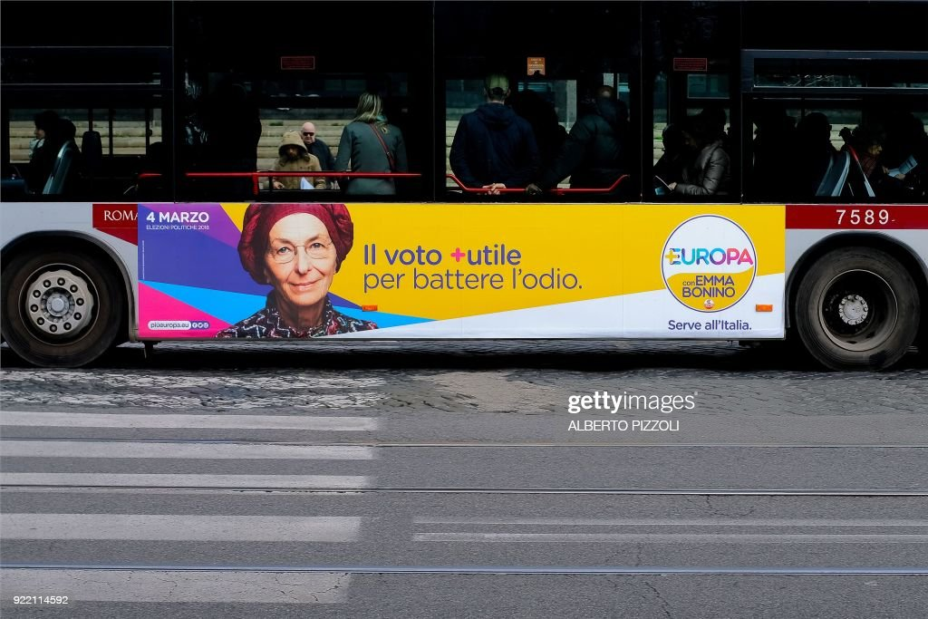 An election poster for the Europa party is seen on the side of a bus in Rome on February 21, 2018 ahead of the March 4 general elections. Italy heads to the polls next month to vote in a crowded general election, against a backdrop of populist gains in Europe, and the shadow of ex-leader Silvio Berlusconi still looms large. / AFP PHOTO / Alberto PIZZOLI