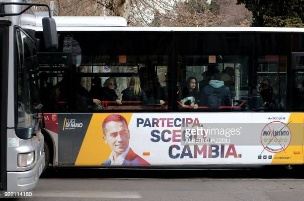 An election poster for the M5s party is seen on the side of a bus in Rome on February 21 2018 ahead of the March 4 general elections Italy heads to...